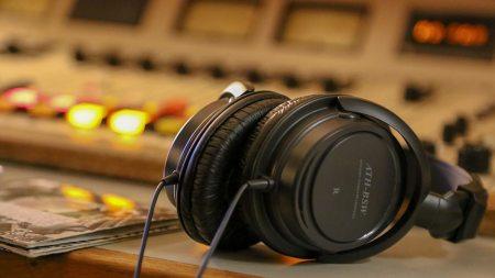 headphones sitting a desk.