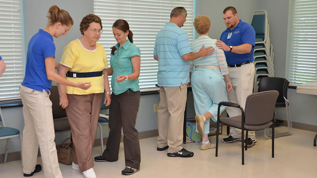 Gabrielle Scronce (center) works with a patient.