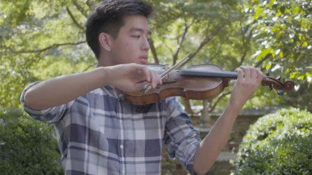 A man plays a violin.