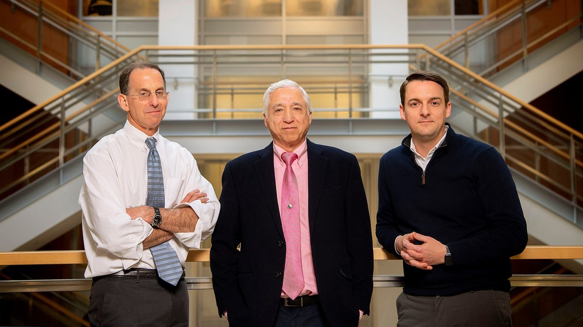 Dr. David Margolis, J. Victor Garcia and Richard Dunham in the Genetic Medicine Building.