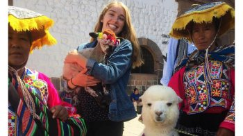 Erin Hager holds an alpaca in Chile.