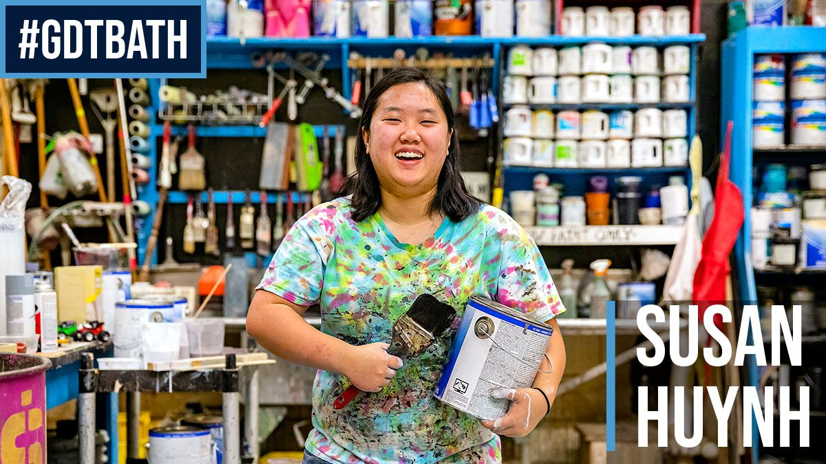 Susan Huynh with paint can and brush
