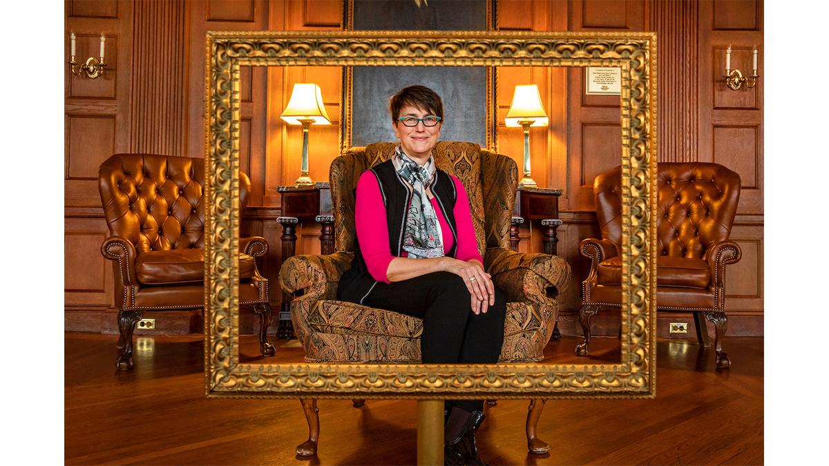 Barbara Fredrickson sits in a decorative chair in a lounge