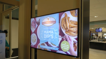 A TV screen that says Mama Dips resturant takeover happening now.