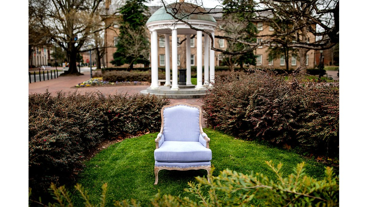 A Carolina blue chair in front of the Well.