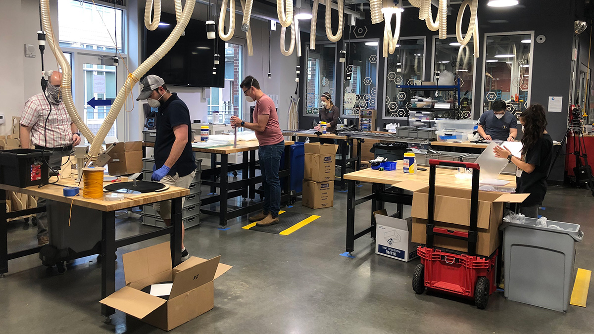 Carolina students work on producing face shields in the University's makerspace.