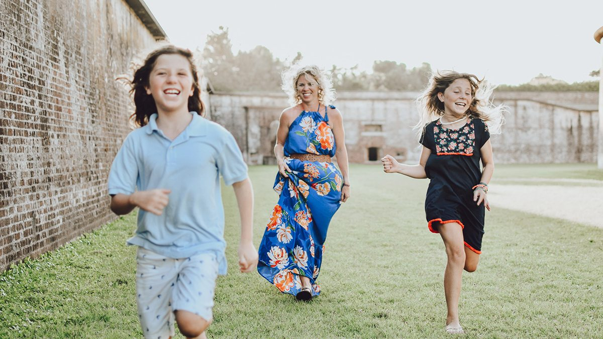 Becky Hoover running with her children.
