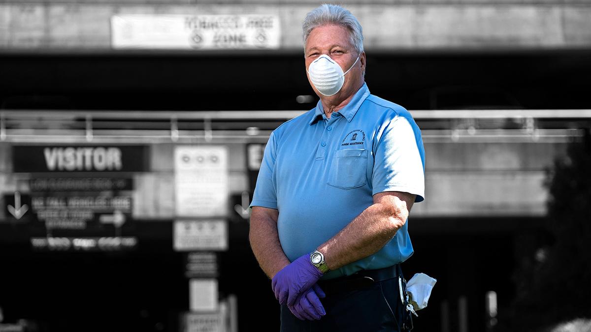a man wears a mask.