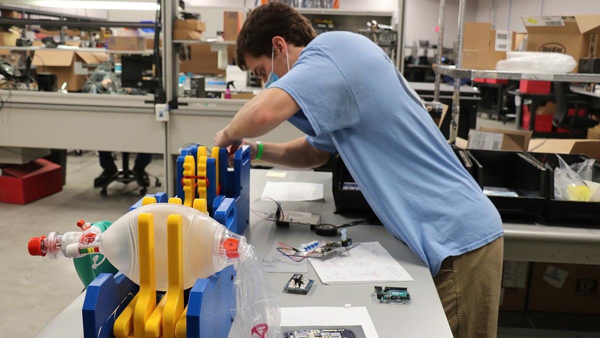Thomas Kierski works on the ventilator prototype.