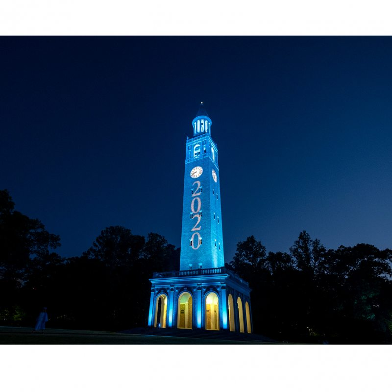 The Bell Tower lit up in Carolina blue.