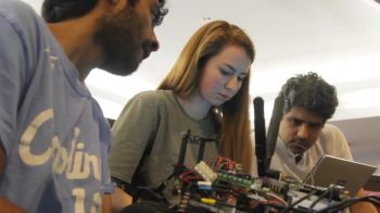 Students work on a remote-controlled car.
