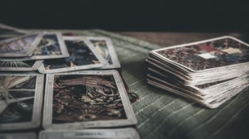 Occult mystic tarot deck on a table.