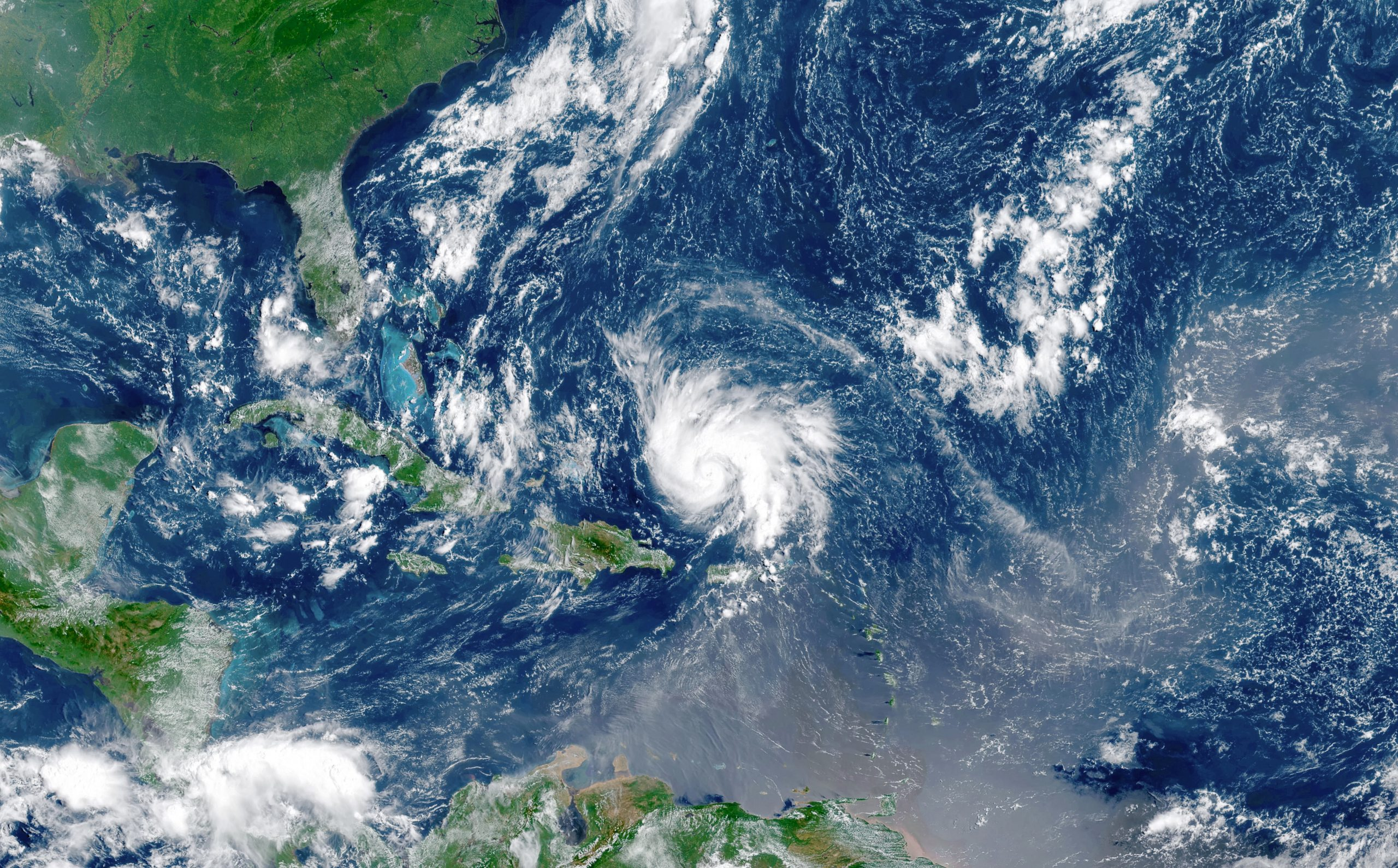 A satellite view of a hurricane forming in the Atlantic Ocean.