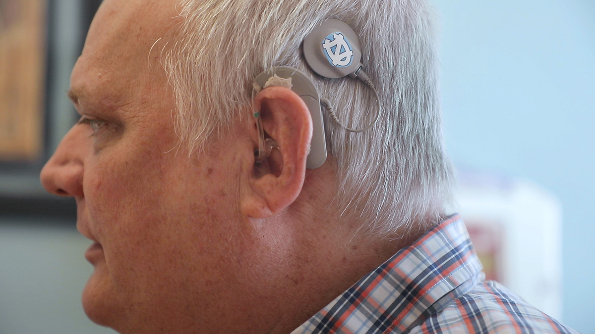 A man wearing a cochlear implant.