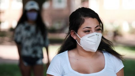 A female student wearing a face mask.