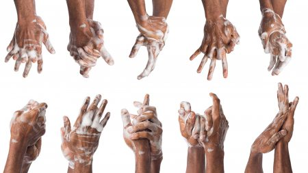 An image of several hands being washed.