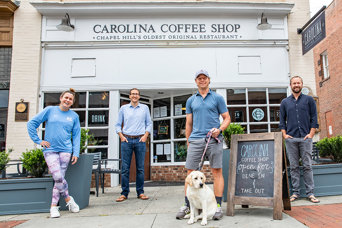 Heather O'Reilly, Clay Schossow, David Werry and Jeff Hortman stand outside the Carolina Coffee Shop.