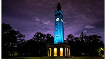 The Bell Tower lit up with blue lights.