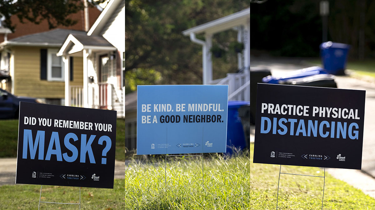 Yard signs encourage mask wearing and physical distancing