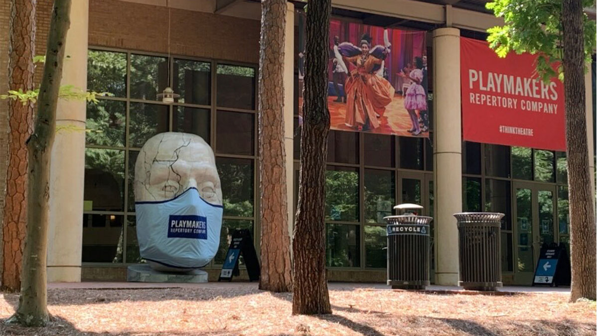 """A masked statue of Caesar from PlayMakers Repertory Company's production of """"Julius Caesar"""" sits outside the Joan H. Gillings Center for Dramatic Art."""
