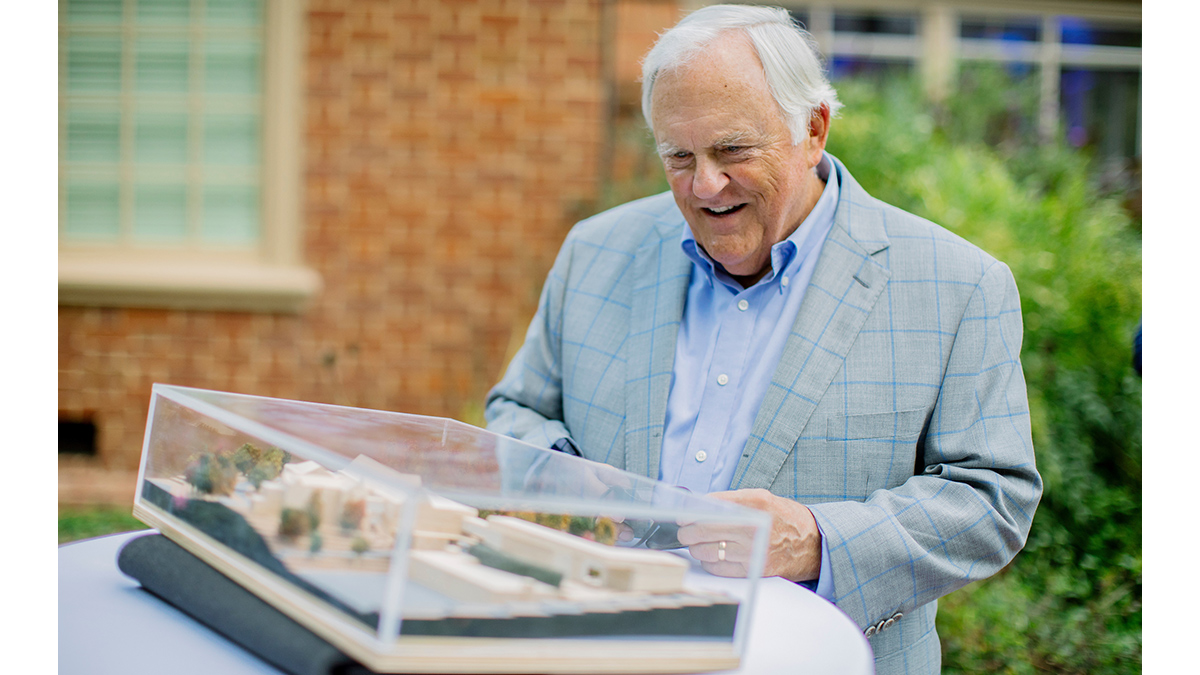 Steve Bell examines a model for a proposed new building.