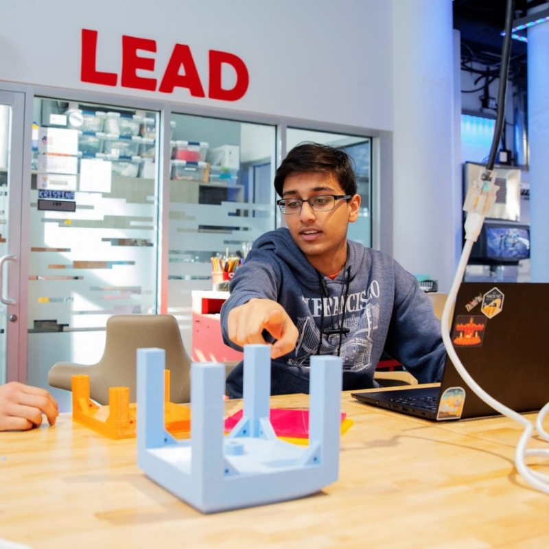 QUVI founders Kush Jain (right) and Harshul Makwana (left) working on their initial water bottle sanitation prototype for the UNC Makeathon.