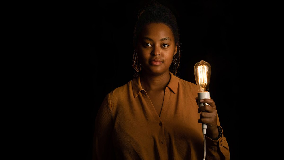 Lenore Hango holds a lightbulb.