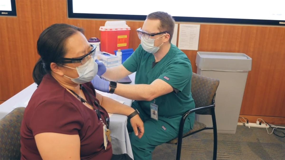 Loc Culp gets a COVID-19 vaccine.