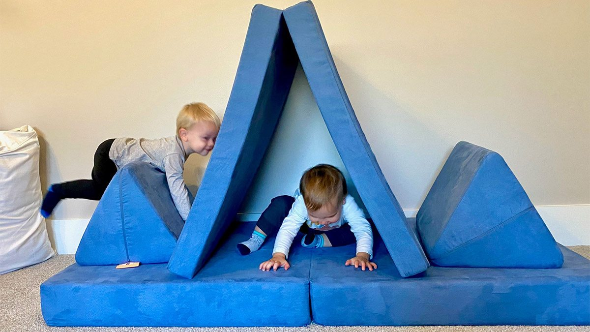 Two children play on a Nugget sofa