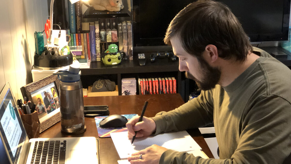 Jesse Bethany works at a desk in his home.