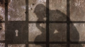 shadow of person thinking in prisons