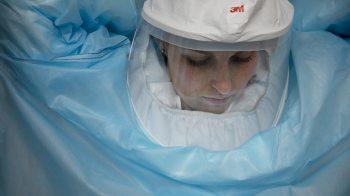 UNC researcher prepares to enter the lab