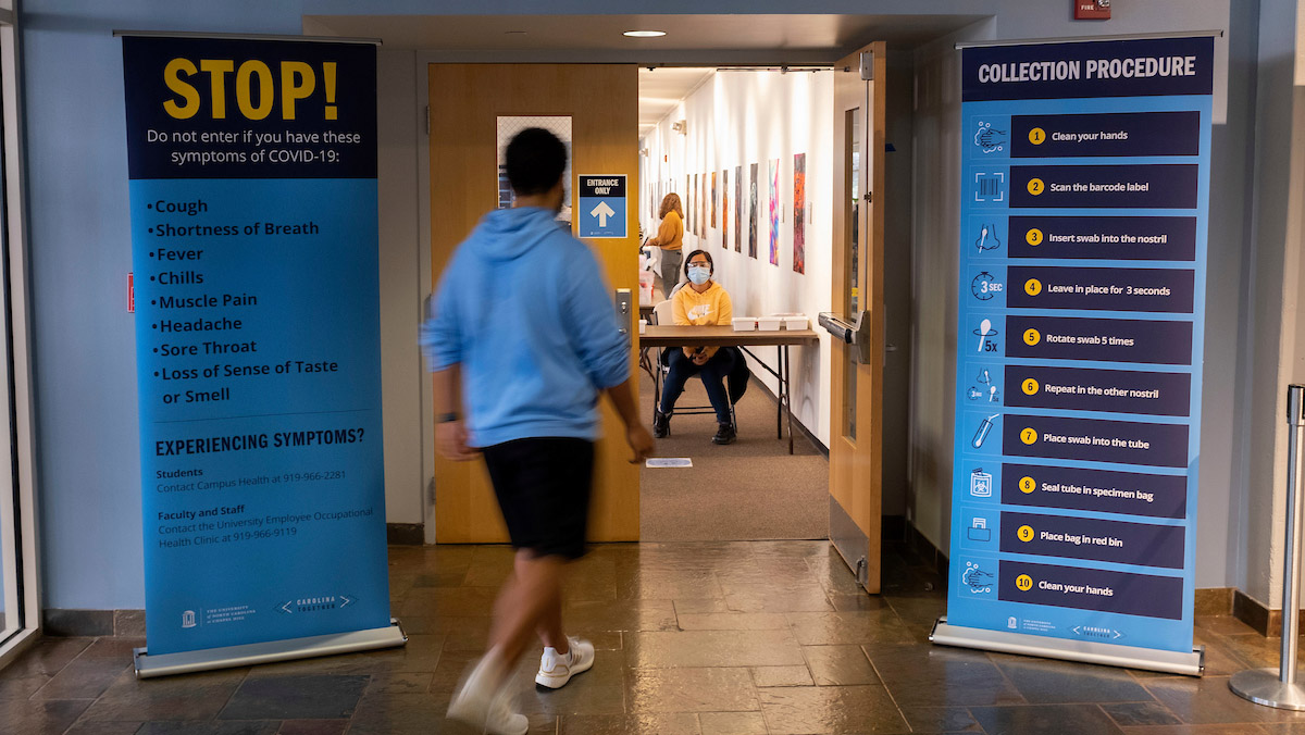 A student walks into a Carolina Together Testing site.