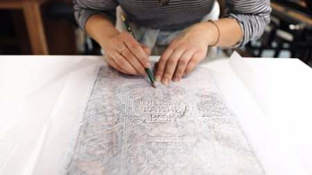 unc student creates yanotype prints from the rubbings of book covers