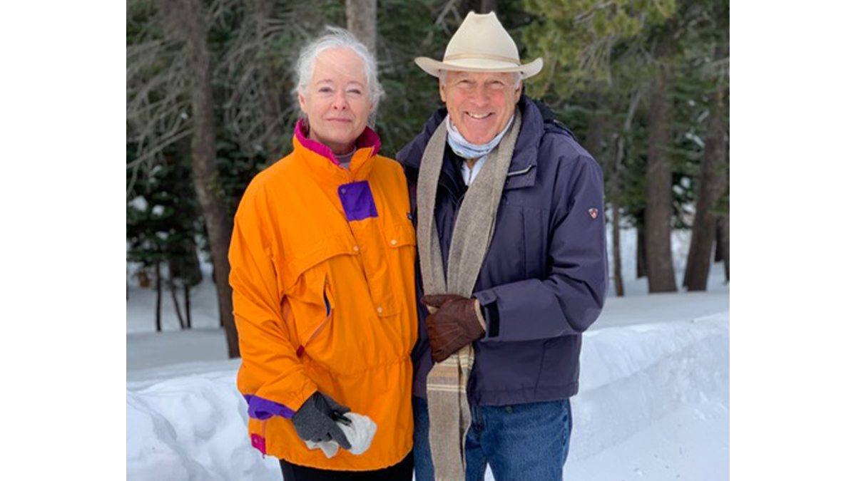 Nancy and Doug Abbey in the woods.