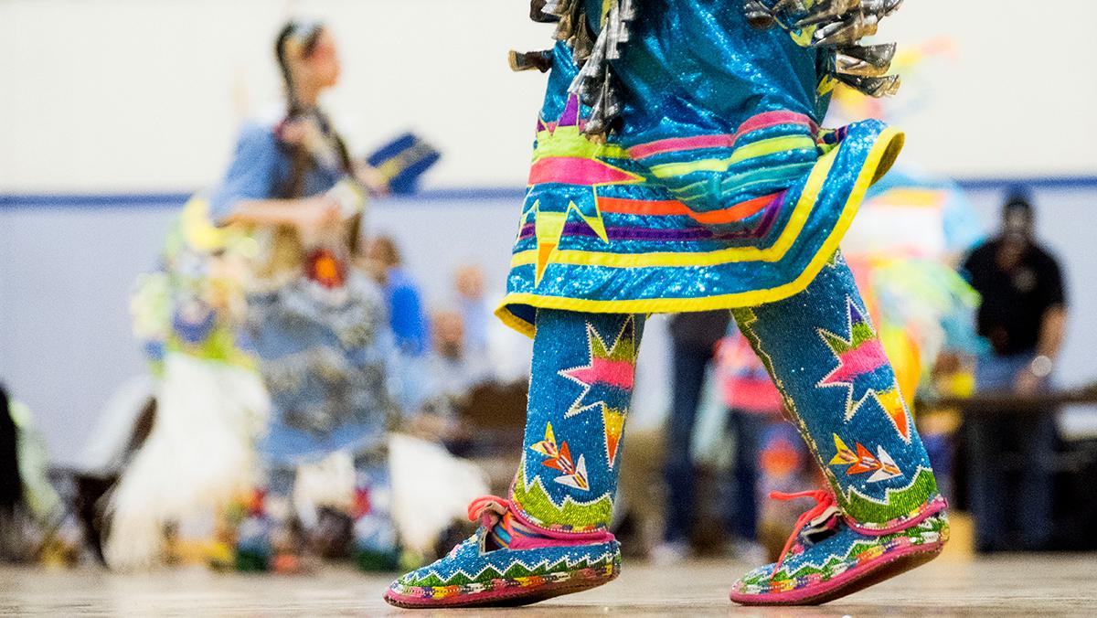 A powwow dancer in Fetzer Hall