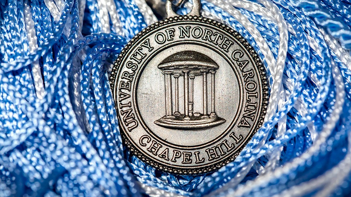 A UNC-Chapel Hill graduation tassel with an Old Well on it.