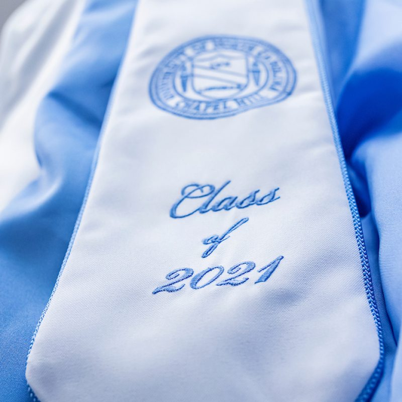 A detailed close up of a graduation stole that has