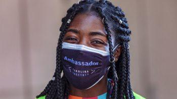 Lauren Thompson poses for a portrait in a Carolina Together Ambassador mask.