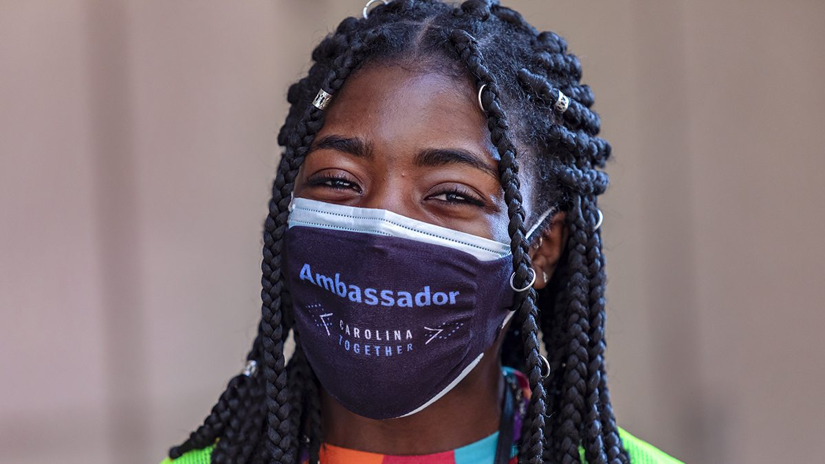 Lauren Thompson poses for a portrait in a Carolina Together Ambassador mask.