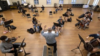 UNC Symphony Orchestra practices six feet apart on campus.