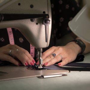 A woman using a sewing machine.