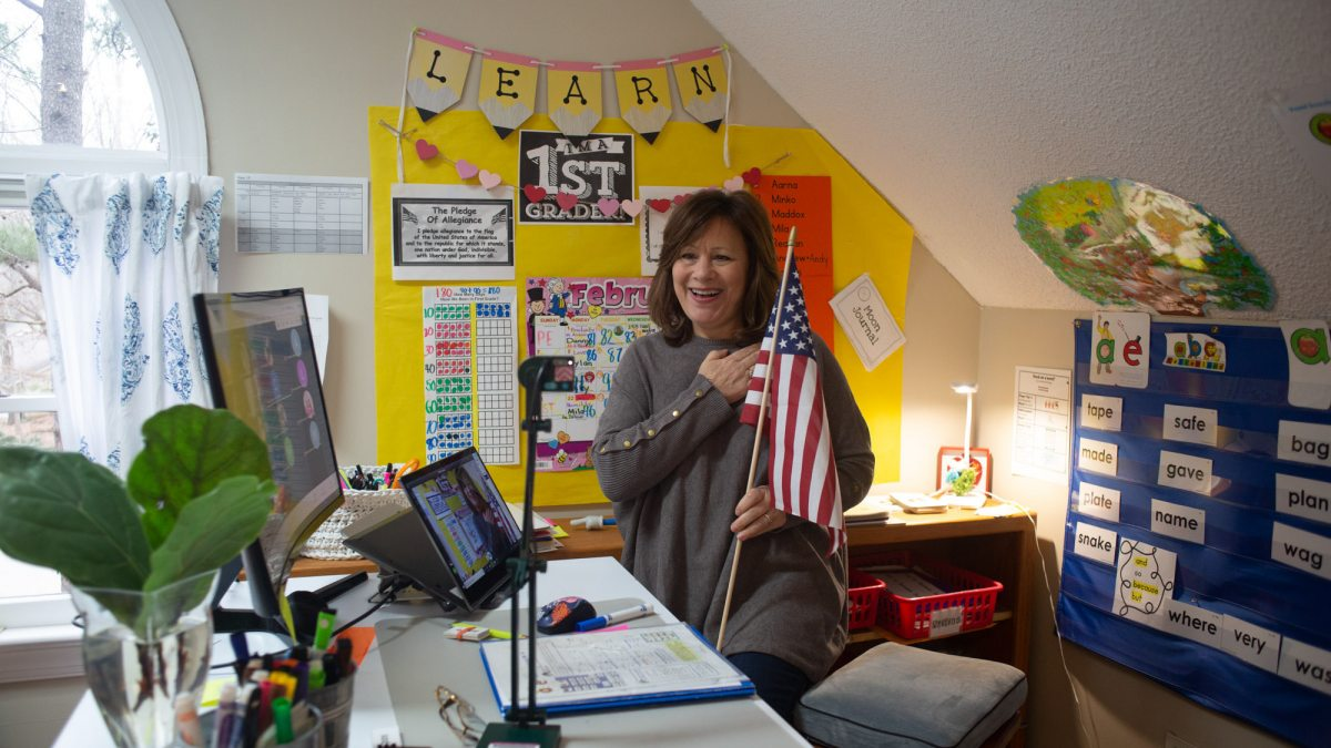 Suzanne Zaccardo holds an American flag while saying the pledge of allegiance.