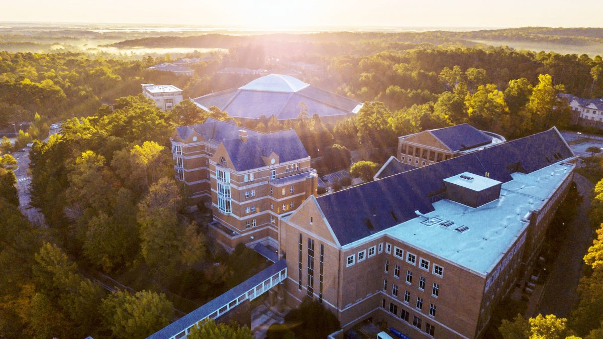 An aerial photo of the UNC Kenan-Flagler's two brick buildings.