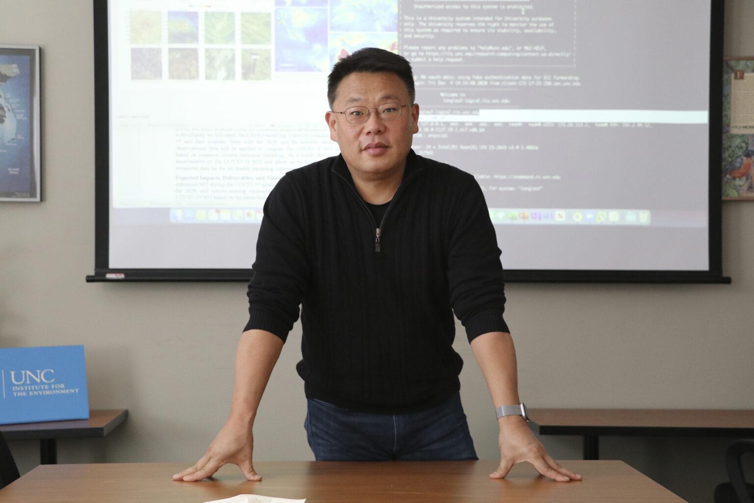 Bok Haeng Baek stands at a table.