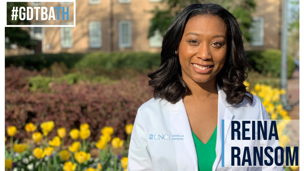 Reina Ransom in a white coat by the Old Well.