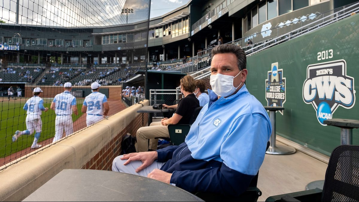 Mario Ciocca sits in the stands of a baseball stadium.