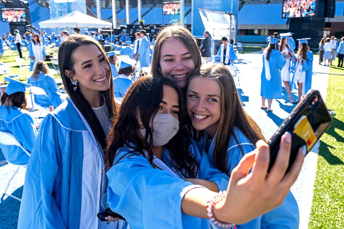 Four students pose for a selfie together.