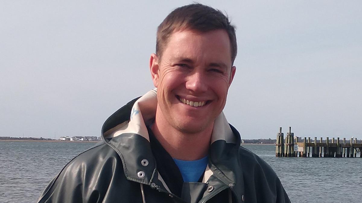 Jon Lucas standing near the coast.