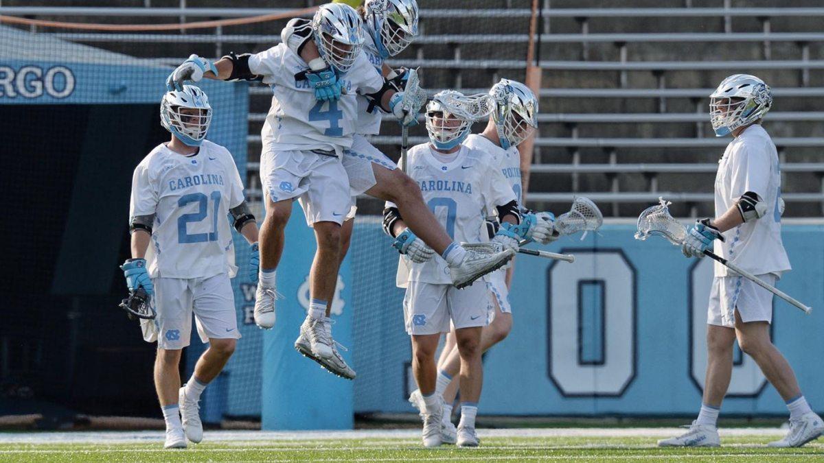 Players from Carolina's men's lacrosse team celebrate.